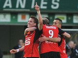Rennes' Norwegian midfielder Anders Konradsen celebrates with teammates after scoring a goal during the French L1 football match between Nantes and Rennes on February 23, 2014