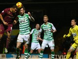 Troy Deeney of Watford has his header blocked by Shane Duffy of Yeovil Town during the Sky Bet Championship match on February 18, 2014