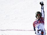 Gold Medallist, Russia's Vic Wild celebrates at the Men's Snowboard Parallel Giant Slalom Final at the Rosa Khutor Extreme Park during the Sochi Winter Olympics on February 19, 2014