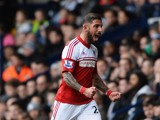 Ashkan Dejagah of Fulham celebrates as he scores their first goal during the Barclays Premier League match between West Bromwich Albion and Fulham at The Hawthorns on February 22, 2014