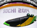 Pilot Winston Watts and Marvin Dixon of Jamaica team 1 make a run during the Men's Two-Man Bobsleigh heats on Day 9 of the Sochi 2014 Winter Olympics at Sliding Center Sanki on February 16, 2014