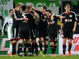Leverkusen´s players celebrate during the German first division Bundesliga football match VfL Wolfsburg vs Bayer Leverkusen on February 22, 2014