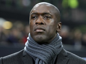 AC Milan coach Clarence Seedorf looks on before the UEFA Champions League Round of 16 match between AC Milan and Club Atletico de Madrid at Stadio Giuseppe Meazza on February 19, 2014