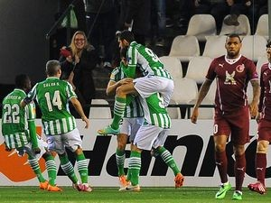 Real Betis' Didac Vila celebrates with teammates after scoring against Rubin Kazan during their Europa League match on February 20, 2014