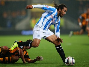 Duane Holmes of Huddersfield Town in action during the Capital One Cup third round match between Hull City and Huddersfield Town at the KC Stadium on September 24, 2013