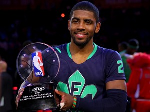 The Eastern Conference's Kyrie Irving #2 of the Cleveland Cavaliers celebrates with the Kia NBA All-Star Game MVP trophy after the 2014 NBA All-Star game at the Smoothie King Center on February 16, 2014