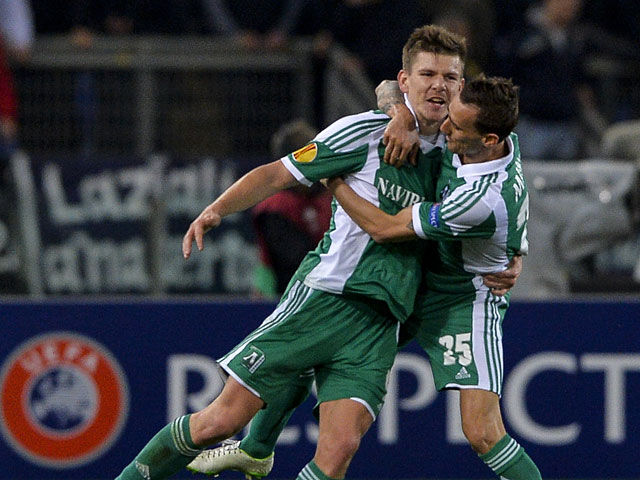 Ludogorets Razgrad's Roman Bezjak celebrates with teammate Yordan Minev after scoring against Lazio during their Europa League match on February 20, 2014