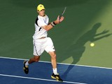 Italy's Andreas Seppi returns the ball to Germany's Florian Mayer during their day one match in the Dubai Duty Free Tennis Championships on February 24, 2014