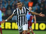 Juventus' Arturo Vidal celebrates after scoring the opening goal against Trabzonspor during their Europa League match on February 27, 2014