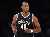 Jason Collins of the Brooklyn Nets runs down the court against the Los Angeles Lakers at Staples Center on February 23, 2014