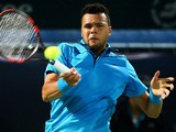 Jo-Wilfried Tsonga returns the ball to Victor Hanescu during their match in the ATP Dubai Duty Free Tennis Championships on February 25, 2014