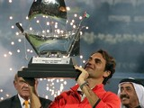 Roger Federer of Switzerland celebrates with his trophy after defeating Tomas Berdych of Czech Republic during their final match in the ATP Dubai Duty Free Tennis Championships on March 1, 2014