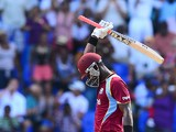 West Indies batsman Darren Sammy celebrates a quick half century during the first One Day International match bewteen West Indies and England at the Sir Vivian Richard Stadium in St John's, February 28, 2014