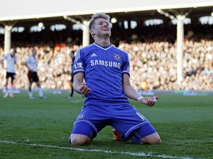 Chelsea's German striker Andre Schurrle celebrates scoring his third goal to complete his hattrick during the English Premier League football match between Fulham and Chelsea at Craven Cottage in London on March 1, 2014