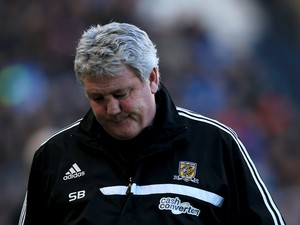 Steve Bruce manager of Hull City looks despondent during the Barclays Premier League match between Hull City and Newcastle United at KC Stadium on March 1, 2014