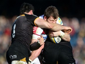 Mark Cueto of Sale Sharks is tackled by Wasps pair Matt Mullan (R) and Andrea Masi (L) during the Aviva Premiership match on March 1, 2014