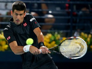 Novak Djokovic returns the ball to Denis Istomim during their match in the ATP Dubai Duty Free Tennis Championships on February 25, 2014
