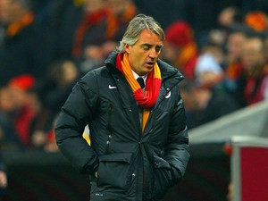 Galatasaray head coach Roberto Mancini on the touchline against Chelsea during his team's Champions League match on February 26, 2014