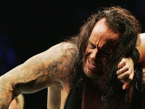 The Undertaker (L) pushes Bam Neely into the corner during WWE Smackdown at Acer Arena on June 15, 2008