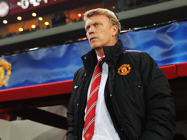 Manchester United manager David Moyes looks on prior to kick-off against Olympiakos in their Champions League match on February 25, 2014