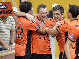 Brisbane's Besart Berisha celebrates with teammates after scoring against Adelaide in their A-League match on March 9, 2014