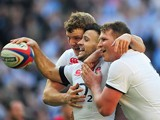 England's Canny Care celebrates with teammates after scoring the first try against Wales during their Six Nations international match on March 9, 2014