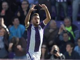 Real Valladolid's Fausto Rossi celebrates after scoring the opening goal against Barcelona during their La Liga match on March 8, 2014