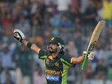 Pakistan's Fawad Alam celebrates after scoring a century (100 runs) during the final match of the Asia Cup one-day cricket tournament against Sri Lanka on March 8, 2014
