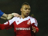 Jacob Murphy (R) of Swindon Town is challenged by Craig Alcock (L) of Peterborough United during the Johnstone's Paint Southern Area Final Second Leg match on February 17, 2014