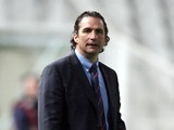 Valencia's Head Coach Juan Antonio Pizzi looks on during his team's Europa League football match against Dynamo Kyiv (Kiev) on February 20, 2013
