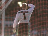 Peter Schmeichel shields his eyes from the sun during Manchester United's match with Sunderland on March 08, 1997.
