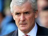 Mark Hughes the Stoke manager looks on during the Barclays Premier League match between Norwich and Stoke at Carrow Road on March 8, 2014