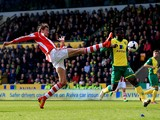 Peter Crouch of Stoke stretches in vain to reach a cross during the Barclays Premier League match between Norwich and Stoke at Carrow Road on March 8, 2014