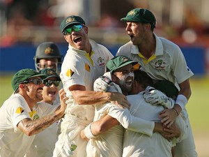 Australian players celebrate after winning the game during day 5 of the third test match between South Africa and Australia at Sahara Park Newlands on March 5, 2014