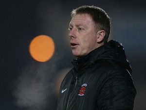 Hartlepool United assistant manager Craig Hignett looks on during the FA Cup with Budweiser Second Round Replay between Coventry City and Hartlepool United at Sixfields Stadium on December 17, 2013