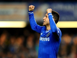 Chelsea's Eden Hazard celebrates after scoring his team's second goal via the penalty spot against Tottenham during their Premier League match on March 8, 2014