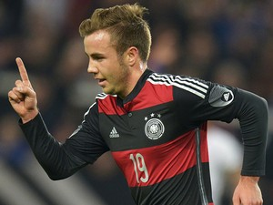 Germany's midfielder Mario Gotze celebrates after he scored during the International friendly football match Germany vs Chile in Stuttgart, southwestern Germany, on March 5, 2014