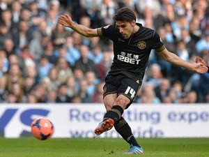 Wigan's Jordi Gomez scores the opening goal via the penalty spot against Manchester City during their FA Cup quarter-final match on March 9, 2014