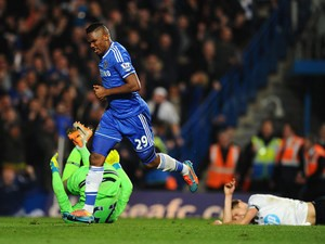 Chelsea's Samuel Eto'o celebrates after scoring his team's opening goal against Tottenham during their Premier League match on March 8, 2014