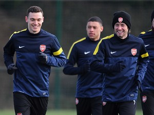 Thomas Vermaelen and Tomas Rosicky of Arsenal during a training session at London Colney on March 12, 2013