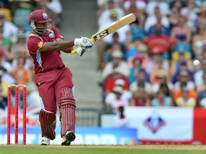 West Indies cricketer Dwayne Smith hits a boundary during the first T20 match between England and West Indies at the Kensington Oval in Bridgetown on March 9, 2014