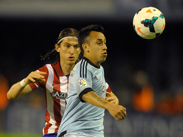 Celta's Fabian Orellana and Atletico Madrid's Filipe Luis in action during their La Liga match on March 8, 2014
