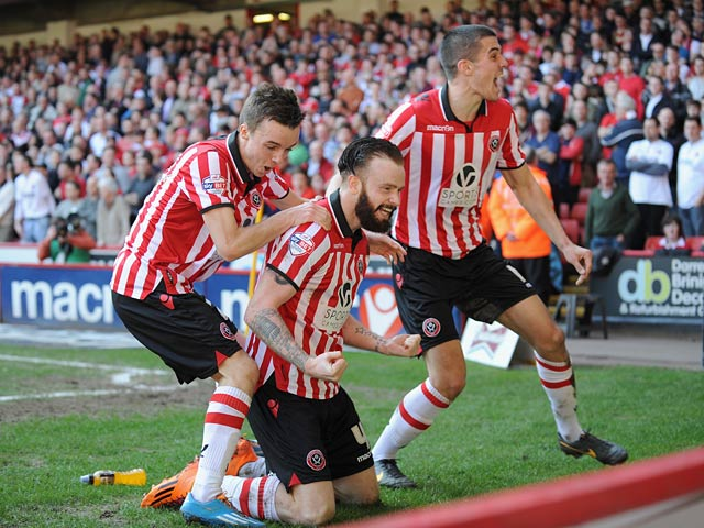 Sheffield United's John Brayford celebrates with teammates after scoring his team's second goal against Charlton during their FA Cup quarter-final match on March 9, 2014