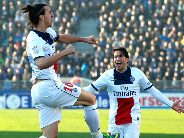 PSG's Zlatan Ibrahimovic celebrates with teammate Maxwell after scoring the opening goal against Bastia during their Ligue 1 match on March 8, 2014