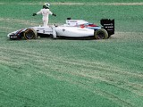 Massa of Brazil and Williams and Kamui Kobayashi of Japan and Caterham come together and spin out into the gravel at turn one at the start of the Australian Formula One Grand Prix at Albert Park on March 16, 2014