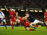 Wales' Jamie Roberts scores a try against Scotland during the Six Nations match on March 15, 2014