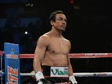 Juan Manuel Marquez stands in his corner before his bout against WBO welterweight champion Timothy Bradley Jr. (not pictured) at the Thomas & Mack Center on October 12, 2013