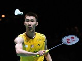 Lee Chong Wei of Malaysia returns against Chen Long of China in their All England Open Badminton Championships men's singles final match in Birmingham, central England, on March 9, 2014