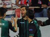 Betis' Leo Baptistao is congratulated by teammates after scoring against Sevilla during their Europa League match on March 13, 2014