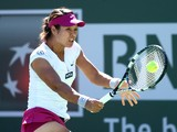 Li Na of China hits a return to Karolina Pliskova of the Czech Republic during the BNP Paribas Open at Indian Wells Tennis Garden on March 9, 2014